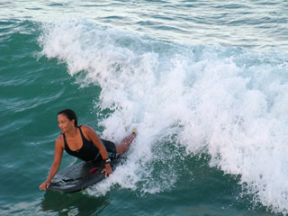 Boogie boarders riding the surf at Waikiki Beach, the young, the old, boys & girls