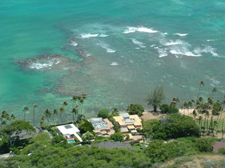 Coral reef and houses near Diamond Head Crater