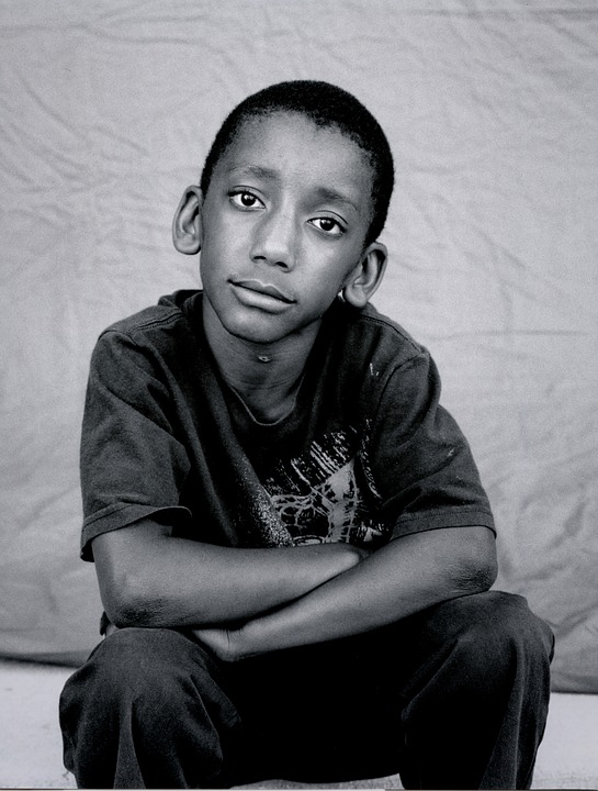 A photo of a homeless African American child.